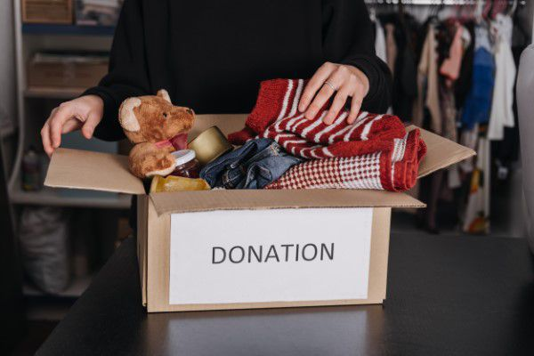 Box of clothes and toys ready to be donated