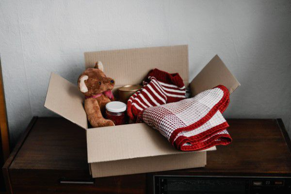 Box of toys and clothes for donation