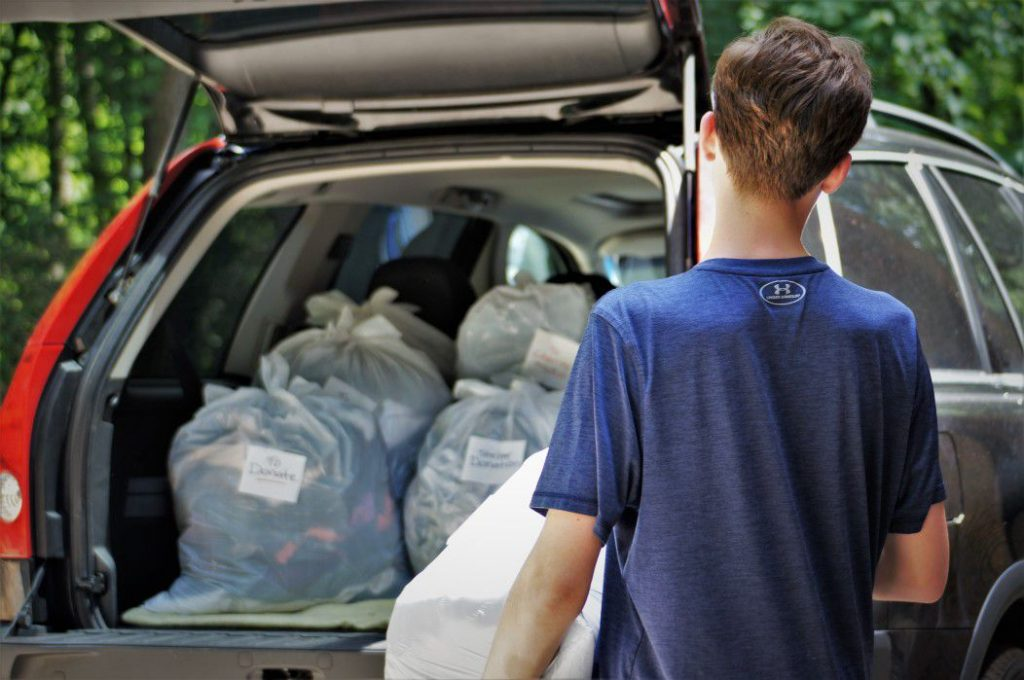 Man preparing clothes for donation